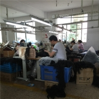 High Machine sewing the weft in the wig cap or hair net